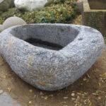 Brunnenfindling aus grauem Granit